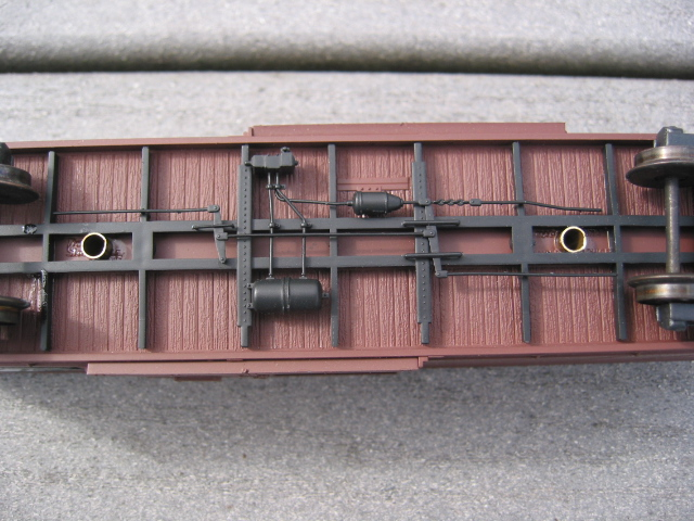 Underframe of car - note brass tubing that lines the holes